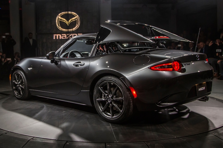 2017-mazda-mx-5-miata-rf-on-stage-rear-three-quarter-view-top-folding